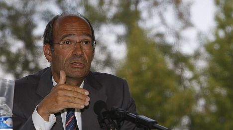 Sarkozy ally charged with influence peddling