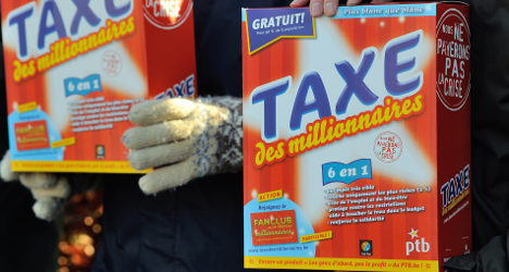 French PM denies plan to ditch 75 percent tax