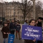 """A protestor near the Eiffel Tower holds a sign reading """"Where's your daddy? And where's your mommy?"""" - the catchphrase of French talkshow host Jacques Martin.Photo: Dan Mac Guill/The Local"""