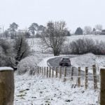 A lone car on a country road near Sallenelles in Normandy on March 11th.Photo: Charly Triballeau/AFP