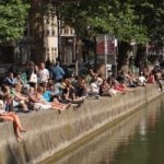 DRINKING OUTDOORS: Because it's cheaper, more spacious and because it's cool, young Parisians are more likely to head outdoors in the summer than into bars or pubs. If you want to blend in with the locals then grab a cheap bottle of wine or a six-pack, and head down to Canal Saint-Martin by Jaurès in the 19th or Quai de Jemmapes in the tenth on a sultry Friday night. If nature calls and you really want to blend in with the locals, find a nearby wall or alleyway to relieve yourself.Photo: Francisco Gonzalez