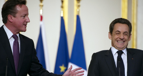 Sarkozy holds 'private' talks with Cameron