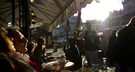 France bans smoking in covered café terraces