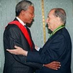 """July 4th, 1994. Then South African president Nelson Mandela embraces his French counterpart François Mitterand in Cape Town, South Africa. The French President had just been given the Order of Good Hope Award by Mandela. Mitterrand was the first French premier to be received by Mandela as president. """"One man, one voice, that is democracy. A liberated society, and no looking back,"""" Mitterand had said.Photo: Gerard Fouet/AFP"""