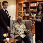 February 29th, 2008. Then French President Nicolas Sarkozy and his wife Carla Bruni are hosted by a smiling Nelson Mandela at the Mandela Foundation in Johannesburg, South Africa.Photo: Remy de Lamauviniere/AFP