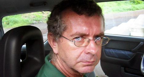 Body of French hostage flown home from Mali