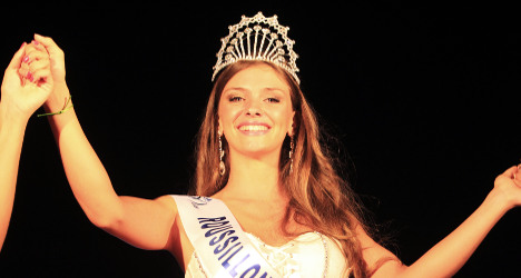 Beauty queen stripped of crown over raunchy pics