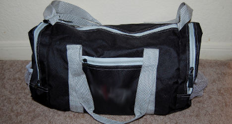 Woman 'carries mother's body in sports bag'