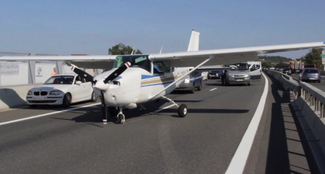 VIDEO: Tourist plane lands on busy motorway