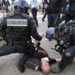 Activists clash with riot police at French bullfight