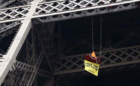 Greenpeace activist protests on Eiffel Tower
