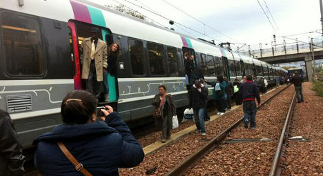 Furious Paris commuters take to the tracks