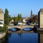 <strong>#4 Happiest – ALSACE.</strong> The smallest region in mainland France, and with Strasbourg on its German border, this eastern pocket of the country doesn't top the table in any category. It did, however, perform very strongly in the three key economic areas – average income, poverty, and employment.Photo: The Ponts Couverts in Strasbourg, Alsace. Jonathan Martz