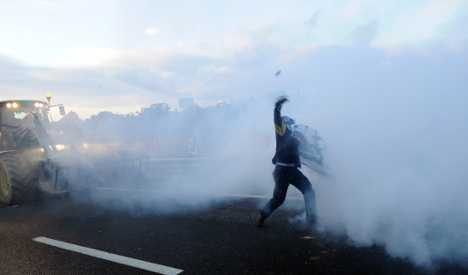 Riot police use tear gas on French tax demo