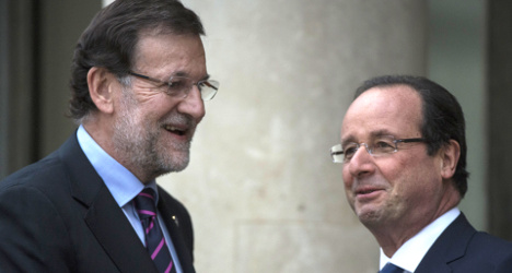 Embattled Hollande flies to Spain in search of ally