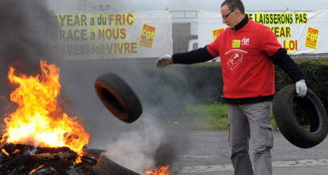Angry French workers protest US takeover bid