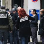 Police arrive at the offices of Liberation on Rue Beranger after the first shooting, in which a photographer was seriously injured.Photo: AFP