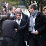 Interior Minister Manuel Valls arrives at the offices of Liberation to view the scene after the first shooting on Monday.Photo: AFP