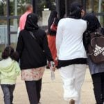 France urged to scrap veil ban for school trips