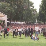 Guests at the traditional Bastille Day garden party rush to welcome South African President Nelson Mandela and his French counterpart Jacques Chirac on the 14 of July , 1996 in the gardens of the Elysee Palace following the military parade where the South African Nobel Peace prize winner was a guest of honour on the second day of his state visit in France.Photo: AFP