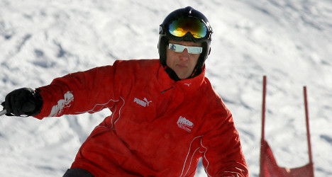 Doctors begin waking Schumacher from coma