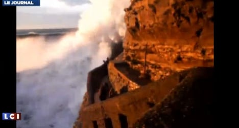 VIDEO: Woman swept out to sea by giant wave