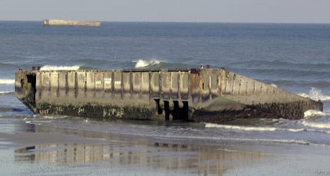Remnants of D-Day harbour wear away at sea