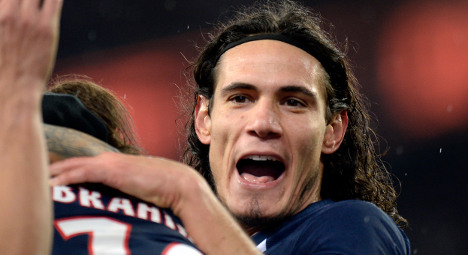 PSG extend lead at top but lose Cavani to injury