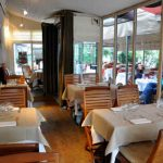 <strong>10. La Cigalle Recamier:</strong> Rumour has it François Hollande regularly dines here, although with whom exactly we do not know. In a restaurant with walls lined with books and tables showered with candles, the cozy ambiance will have your date feeling as if you've already headed home for a night together. Address: 4 Rue Récamier. Website- no website (phone number- 01 45 48 86 58) Photo: Le Figaro