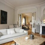 The apartment is in a traditional old Haussmann building and as seen here it features a large lounge/dining room. Photo: Leggett
