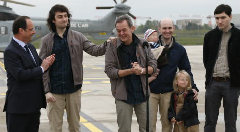 Freed journalists back on French soil
