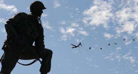 Parachutists fill the skies to mark D-Day landings