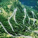 <b>Alpe d'Huez</b> Although most famously known as a marquee stage of the Tour de France, the iconic corkscrew ascent from Bourg d'Oisans to Alpe d'Huez is such a stunning ride that thousands of cyclists, occasional riders or professionals will climb this Mecca of cycling each year. The 21 smooth bends, with stunning views of the Oisans valley, mean you climb 1150 metres at an average slope of 7.9 percent over the 15km ride. The numbers mean very little compared to the exhilaration of the ride.Photo: www.bikehiredirect.com