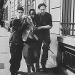 A black French resistance fighter is helped away after being wounded in the battlePhoto: Public resource.org