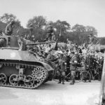 Cheering crowds, flanked by firemen, greets a tank of the Leclerc Division during the military parade, on August 26, 1944 , Place de la Concorde, the day after the Liberation of Paris.Photo: AFP