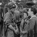 A French soldier of the Leclerc Division is shown discussing with young Parisians on August 25, 1944 during the military parade marking the Liberation of Paris during World War II.Photo: AFP