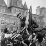 A French soldier of the Leclerc Division riding a tank is greeted by Parisians on August 25, 1944 in front of the city hall during the military parade marking the Liberation of Paris during World War II.Photo: AFP