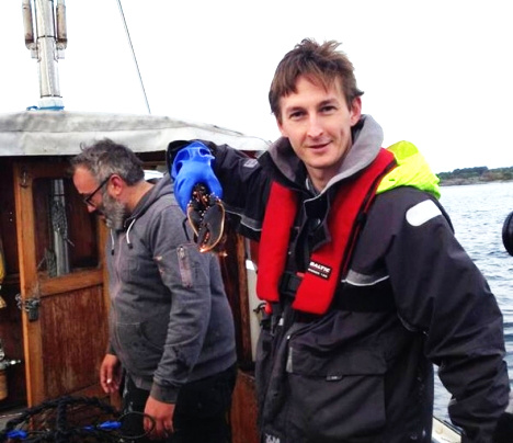 The Local's Oliver Gee catches a lobster