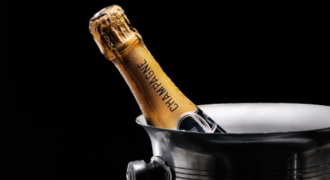 Burglar caught sipping bubbly during break-in
