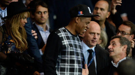 Jay Z and Beyonce bump into Sark-O at the footy