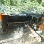 <b>Improvised shelter:</b> Migrants living in a patch of woods near the port used logs, rope, branches and plastic sheeting to build themselves a kitchen and living area. Sleeping quarters are similarly jerry-rigged with pallets serving as walls and floors while tarps serve as a roof. Photo: Joshua Melvin/The Local