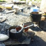 <b>Campfire kitchen:</b> The Calais migrant camps have no official cooking facilities, so the residents use small campfires and a few donated pots to make their meals. In this makeshift kitchen migrants use rocks to balance their cookware over the flames. They have also rigged up a small canopy to keep dry when the weather turns bad.Photo: Joshua Melvin/The Local