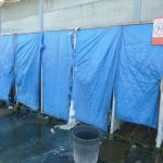 <b>Staying clean:</b> In order to shower the migrants in the Calais camps either have to find a secluded spot in the woods or douse themselves with buckets of frigid water in these improvised stalls. Notice the sign in the top right hand corner that reminds people the toilets are elsewhere.Photo: Joshua Melvin/The Local