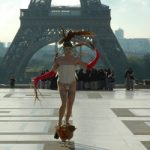 <b>'Coq dance':</b> Dressed in a corset and tights, South African artist Steven Cohen made headlines when he danced around in front of the Eiffel Tower with a live rooster tied to his penis.Photo: Quentin Evrard