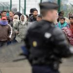 """<b>Migrant headache:</b> """"There are large numbers of illegal migrants in and around Calais, who may seek an opportunity to enter the UK illegally. Although local police patrols have been reinforced, you should keep vehicle doors locked in slow moving traffic and secure your vehicle when it is left unattended."""" (UK gov't)Photo: AFP"""