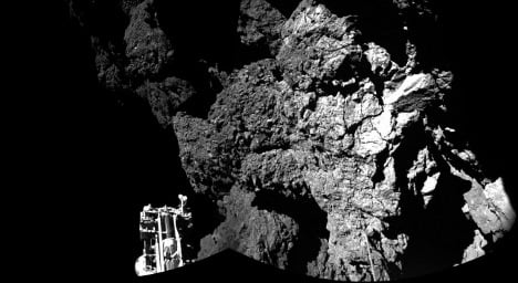 Comet probe Philae 'perched on steep slope'