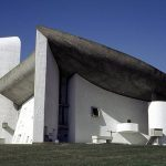 <b>Chapel de Notre Dame de Haut:</b> Designed by Le Corbusier in 1954, the controversy of the Chapel of Notre Dame du Haut in Ronchamp lies not with the original building – as one might have expected of a church shaped liked a mushroom – but with the addition in 2011 of a $16 million visitors' centre and convent by Renzo Piano of Centre Pompidou fame. The dreaded extension was predicted to distract from Le Corbusier's sculptural tour de force – fears that went unfounded, as Piano inserted the new buildings into a grassy slope 300ft from the chapel.Photo: scarletgreen