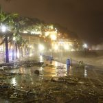 """Strong wind blows into the palm trees on the """"promenade des Anglais"""" strewn with debris on November 4, 2014 in the French Riviera city of Nice"""