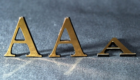 Fitch downgrades France's credit rating