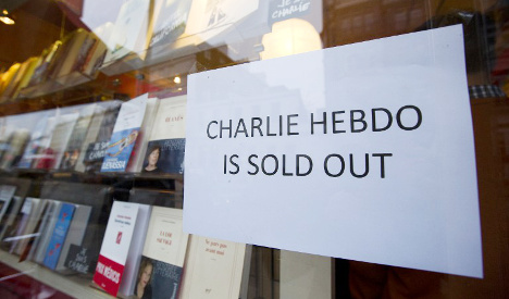 People queue abroad for new Charlie Hebdo mag
